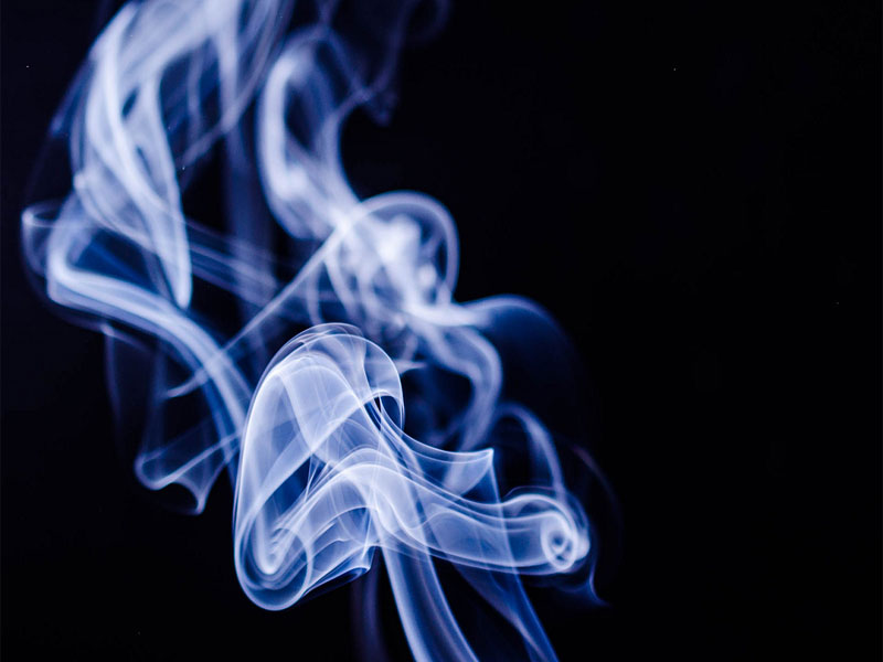 smoking category image showing smoke with a black background