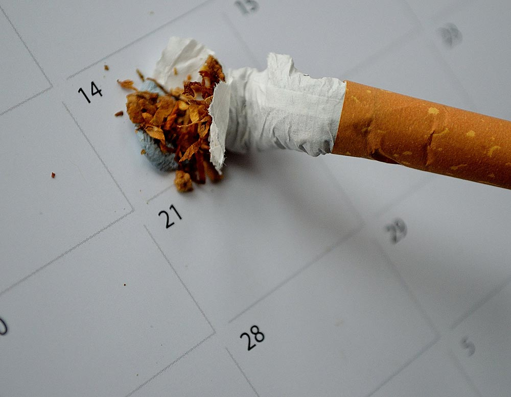 Stop Smoking article showing a cigarette being stubbed out on a calendar