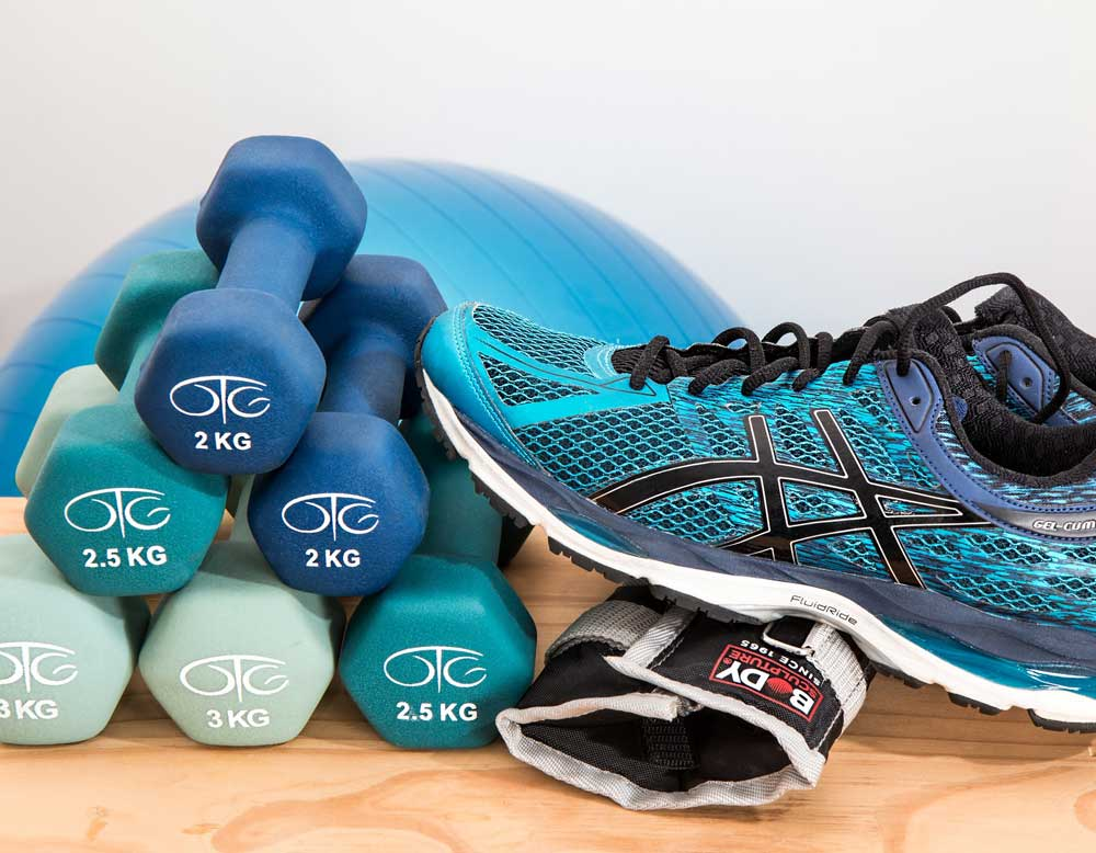Types and how much exercise image of trainers, dumbells and exercise ball